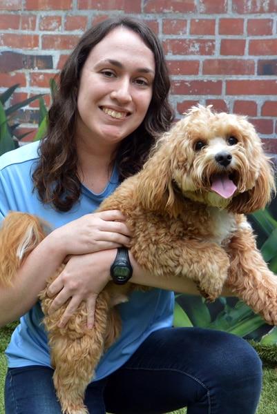 Staff holding a dog