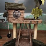 cat in a cat tree in the playroom