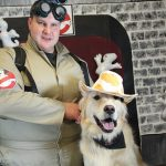 man in a ghost buster's costume; dog in cowboy costume